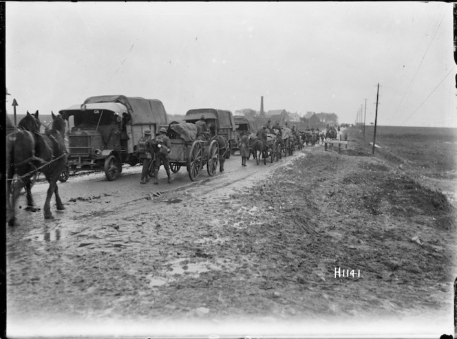 New Zealand military transport moving along a road in Le Quesnoy, France