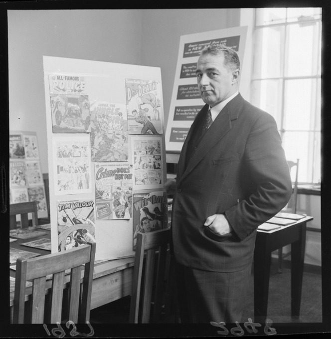 Minister Jack Marshall with a display of disapproved-of comics allegedly corrupting youth.