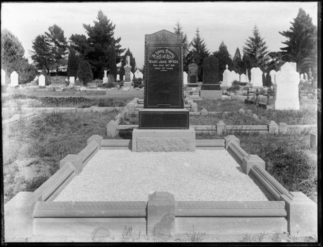 Grave of Mary Jane McKee, 26th of Jun 1899 aged 62, with headstone and rectangular gravel filled plot, other graves beyond, probably Christchurch region