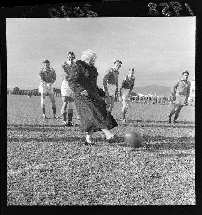 Mrs Huggan (Mayor of Petone) kicking a ball at a Rugby League match