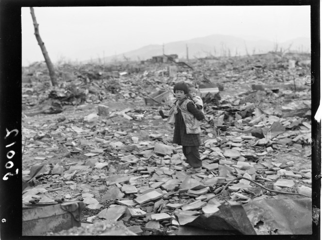 Hiroshima - Small child with baby on back searching for anything of usefulness. New Zealand. Department of Internal Affairs. War History Branch :Photographs relating to World War 1914-1918, World War 1939-1945, occupation of Japan, Korean War, and Malayan Emergency. Ref: J-0012-F. Alexander Turnbull Library, Wellington, New Zealand. http://natlib.govt.nz/records/23130201