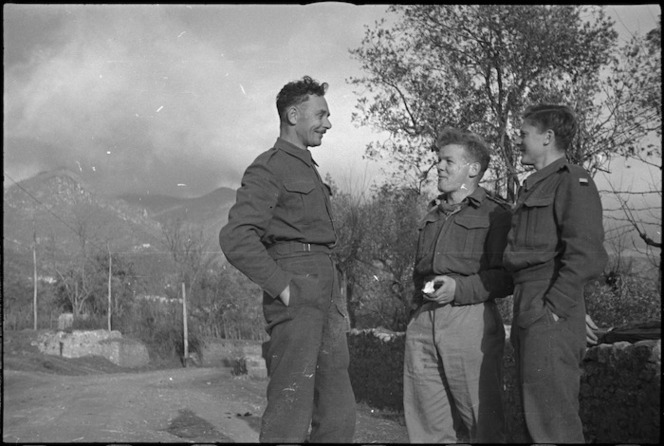 Three New Zealanders chat on the roadside in the Volturno Valley, Italy, World War II - Photograph taken by George Kaye