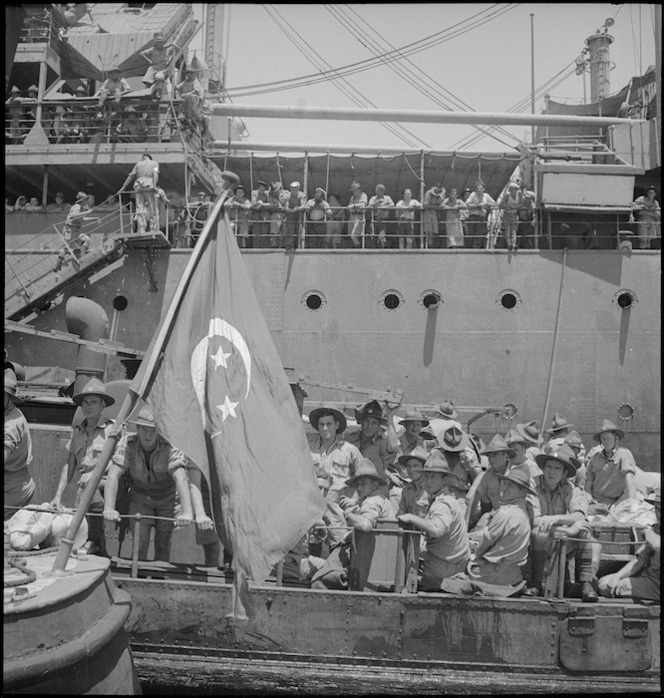 Newly arrived NZ reinforcements transfer from ship to shore by lighter, Port Tewfik, World War II - Photograph taken by S Wemyss