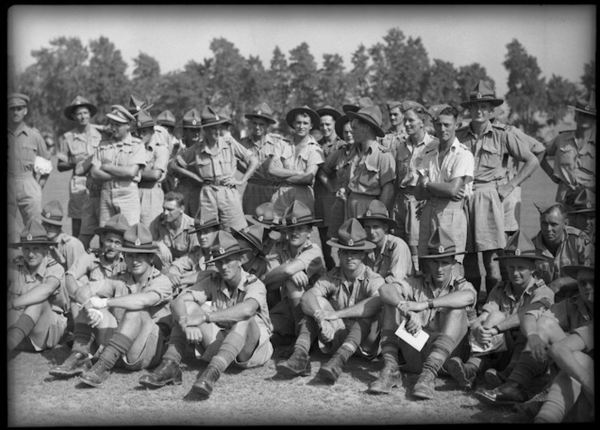Group of NZ Artillerymen looking on during sports fixture between NZ and South African Artillery at Maadi Ground, Egypt - Photograph taken by George Kaye