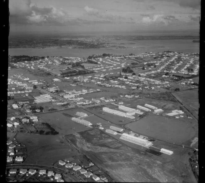 Mount Roskill Grammar College with sports fields, looking to the Manukau Harbour beyond, Onehunga, Auckland