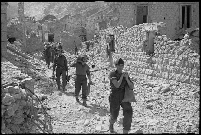 Allied infantry personnel move among ruins of Cassino shortly after the town fell, Italy, World War II - Photograph taken by George Kaye