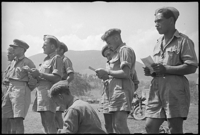 Kiwis noting results of event at 5 NZ Infantry Brigade Sports Meeting in Volturno Valley area, Italy, World War II - Photograph taken by George Kaye