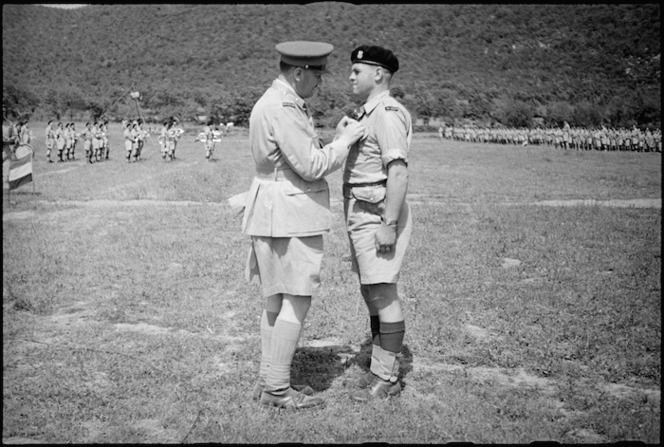 Colonel Clive Lochiel Pleasants receiving the DSO from General Freyberg in the Volturno Valley, Italy, World War II - Photograph taken by George Kaye