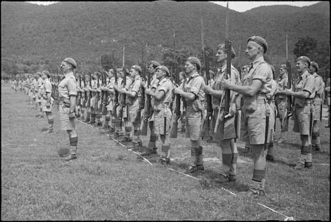 Officers and men of 4 New Zealand Armoured Brigade lined up on ceremonial parade in Volturno Valley, Italy, World War II - Photograph taken by George Kaye