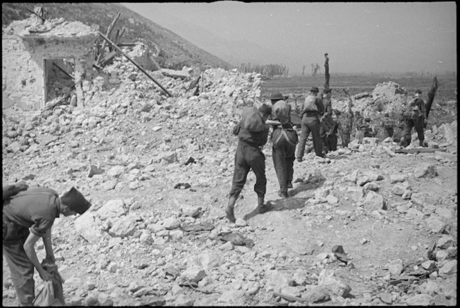 Allied infantrymen moving over the ruins of Cassino on the day it fell to the Allied attack, Italy, World War II - Photograph taken by George Kaye