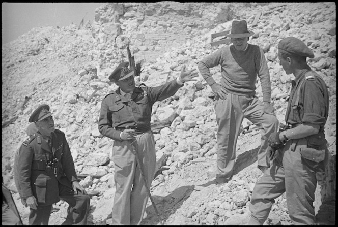 General Bernard Freyberg explains feature of recent Cassino fighting to Peter Fraser and General Edward Puttick, Italy, World War II - Photograph taken by George Kaye