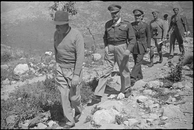 Prime Minister Peter Fraser, accompanied by General Bernard Freyberg and senior officers, climbing Monastery Hill, Cassino, Italy, World War II - Photograph taken by George Kaye