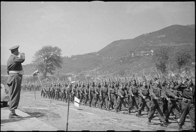 General Freyberg taking the salute during march past of 5 NZ Infantry Brigade in the Volturno Valley, Italy, World War II - Photograph taken by George Kaye