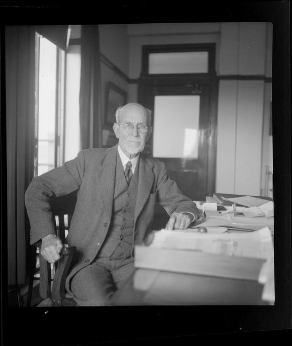 Portrait of Sir Albert Fuller Ellis, British Phosphate Commissioner, sitting at his desk, location unknown