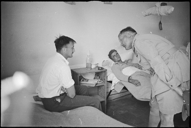 General Bernard Freyberg speaks to a patient at 2 NZ General Hospital, Caserta, Italy, World War II - Photograph taken by George Kaye