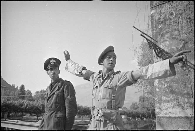 New Zealand Provost R H Blake on duty at the bridge across the Liri River at Sora, Italy, World War II - Photograph taken by George Kaye