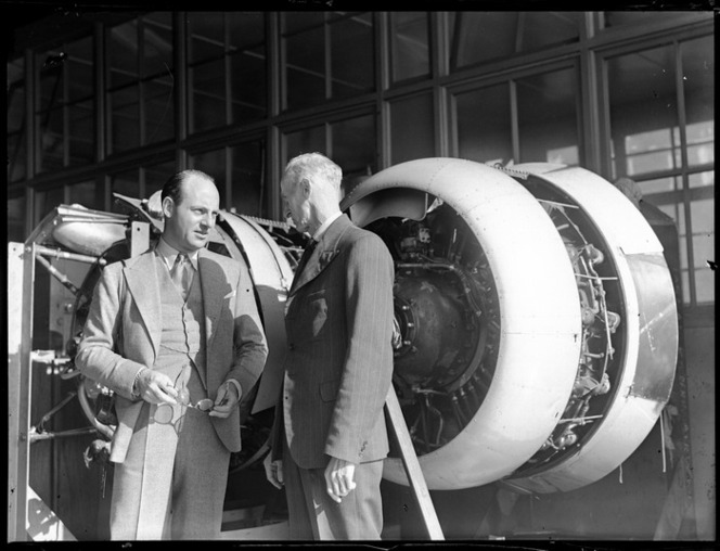 Willard Whitney Straight, of British Overseas Airways Corporation, with Mr Bolt, standing in front of aircraft engines, Auckland