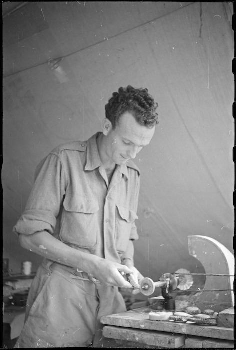 R H Fenton adjusting denture on dental lathe at New Zealand Mobile Dental Unit Headquarters in Italy, World War II - Photograph taken by George Kaye