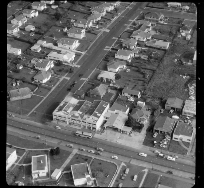 Mt Roskill/Onehunga area, Auckland, including the premises of a business/factory advertising 'The Home of Parisian Coats', and rows of houses