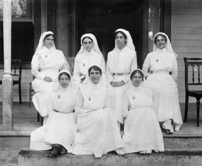 Group portrait of seven nurses on the steps of a hospital in Apia, Samoa, during World War I.