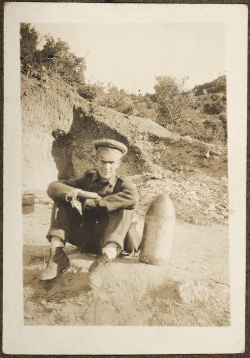 Soldier beside unexploded Turkish shell, Gallipoli Peninsula, Turkey