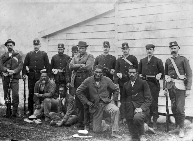 Policemen with a group of Maori who participated in the Dog Tax Rebellion
