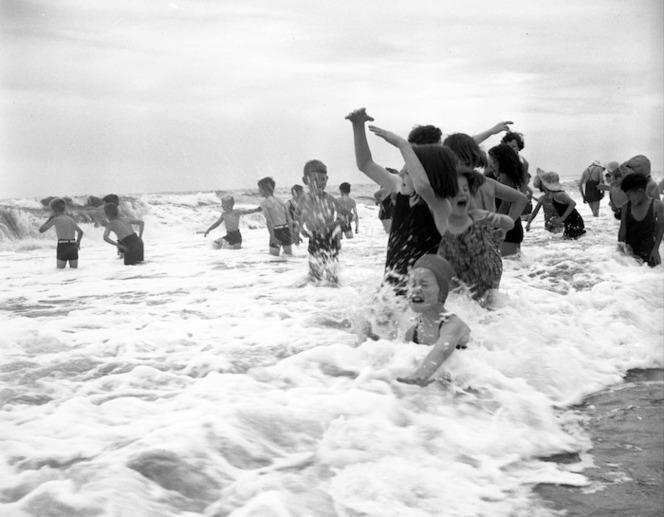 Children playing in the sea, Otaki Beach