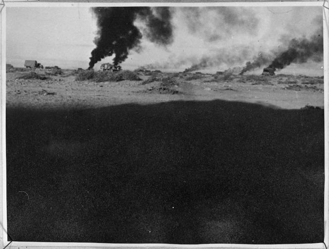 Smoke rising from burning vehicles in Libya, during World War 2 - Photograph taken by Lieutenant Smythe