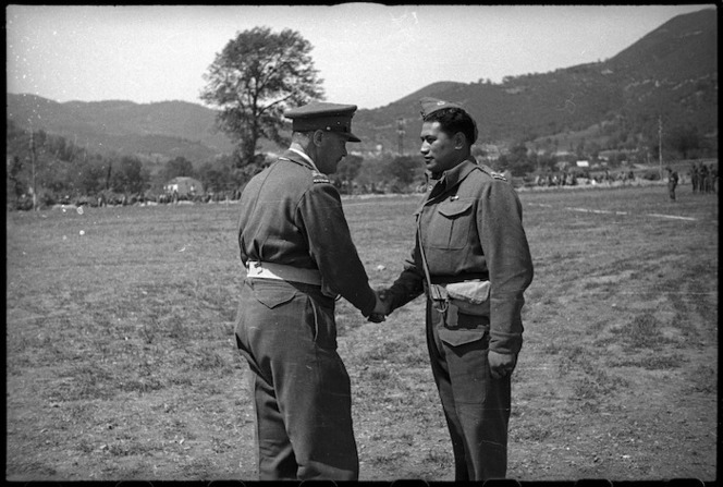 Major J Matehaere, New Zealand World War 2 soldier, receiving the Military Cross from General Freyberg, Italy