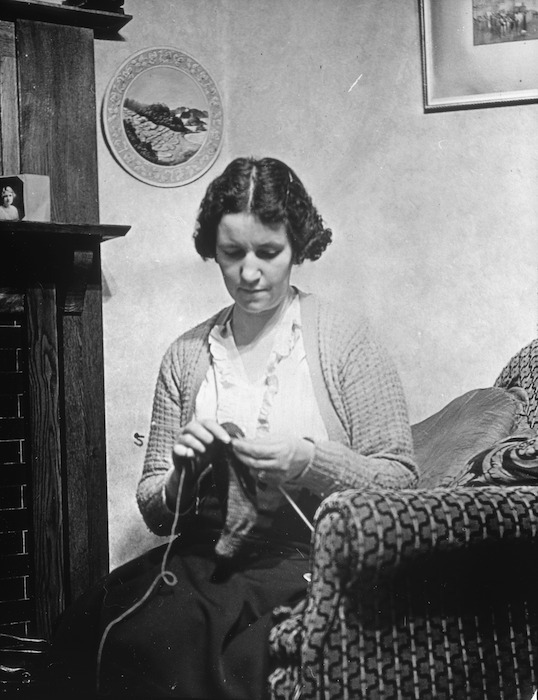 Wife of Charles William Clift at home, knitting, Whaui Street, Vogeltown, Wellington