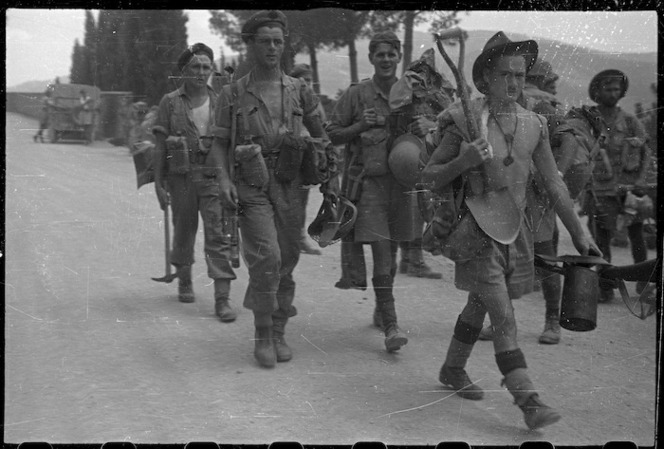 World War 2 New Zealand soldiers of 26 Battalion coming out from the front line, Lignano area, Italy