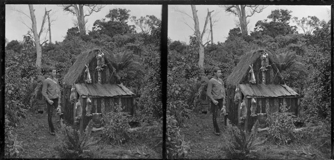 Edgar Williams standing beside a small hut, Pounawea, Catlins River