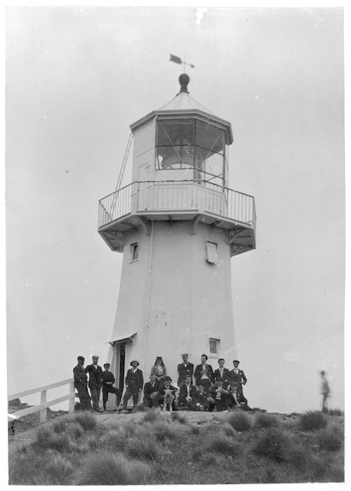 Group gathered in front of Pencarrow Lighthouse, Wellington