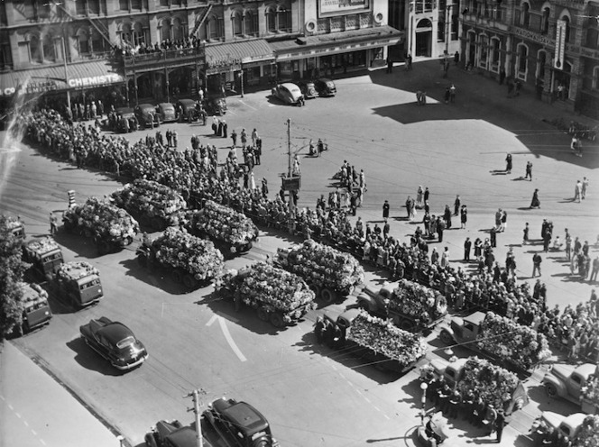 Trucks with wreaths in Cathedral Square, Christchurch, during the funeral service for victims of the Ballantyne's Department Store fire,