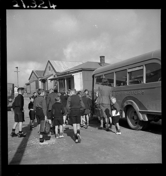 Children boarding the school bus in Denniston