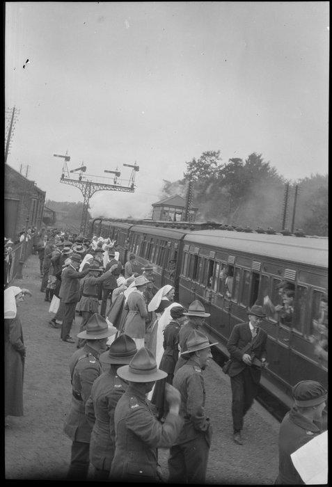 Crowd waving to train passengers