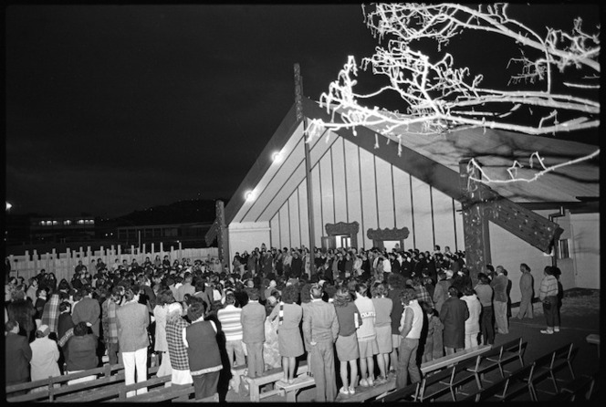 Crowd gathered around the meeting house at the dawn opening of Pipitea Marae, Thorndon Quay, Wellington
