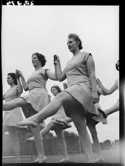 Female trainee physical education instructors performing leg swings, Hutt Valley, Wellington