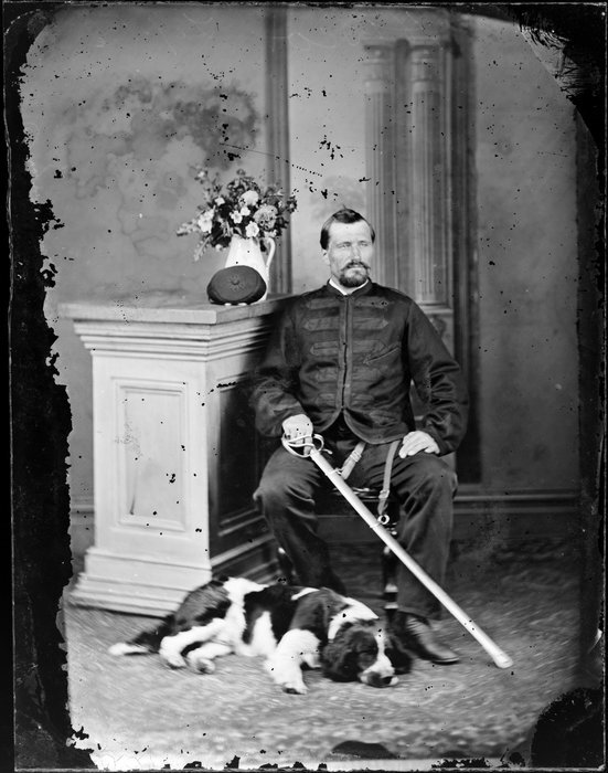 Mr Hiscox, with dog and sabre