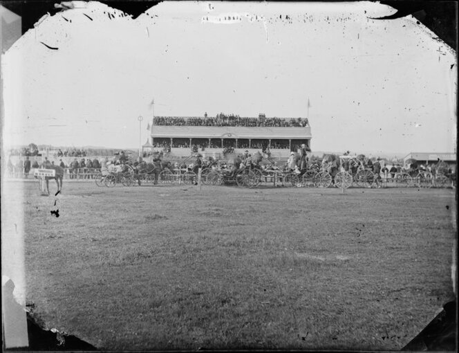 Race meeting at Whanganui with stand and carriages