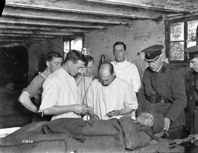 Members of the 2nd NZ Field Ambulance, injecting gum infusion into a patient