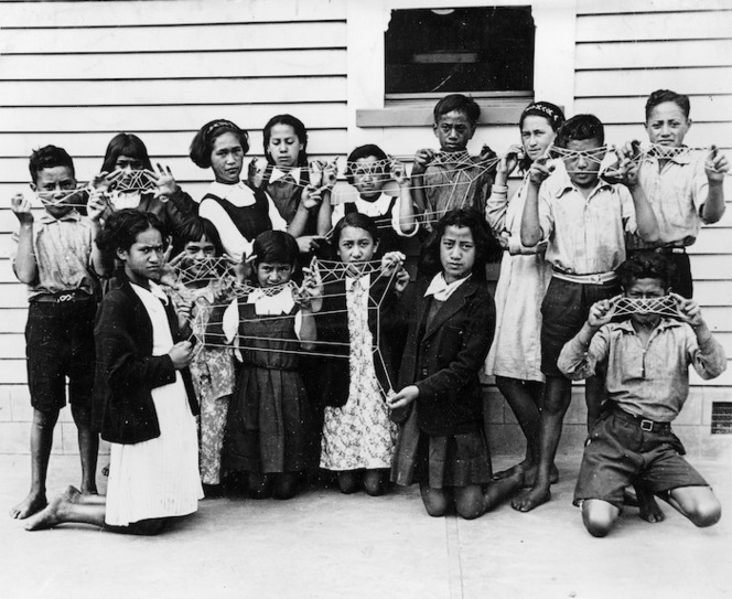 Children holding Maori string patterns