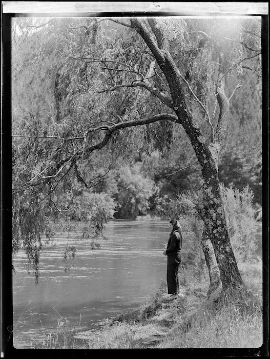 Zeila Wells beside Waikato River, Atiamuri