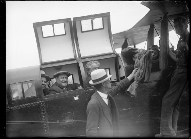 Canterbury Aviation Company's De Havilland DH9 biplane, and passengers