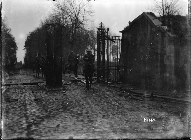 New Zealand Divisional Commander entering Le Quesnoy, France, after its capture during World War I