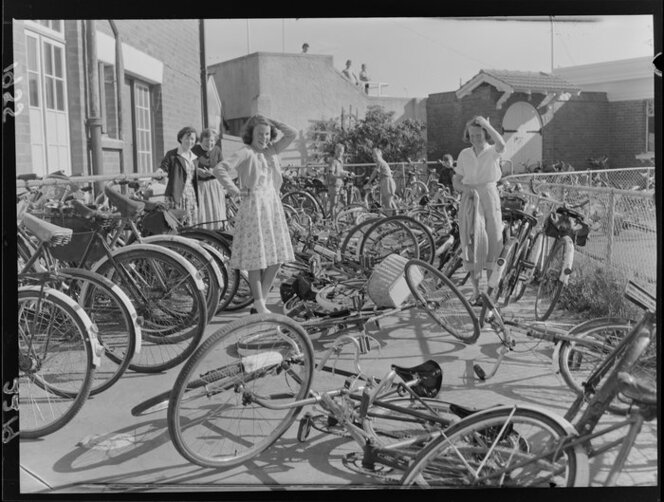 A bicycle rack and a pile of bicycles outside the Riddiford Baths, Lower Hutt