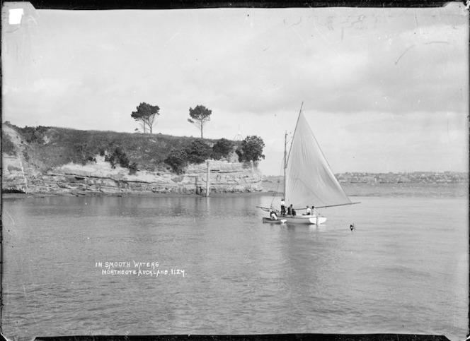 Men sailing a boat at Northcote, Auckland