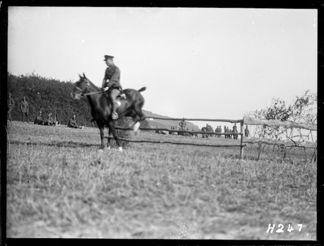 A horse and rider clear a jump at the Anzac Horse Show, World War I