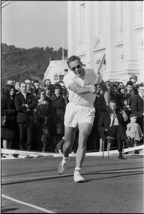 Charlton Heston playing tennis, Mercer Street, Wellington