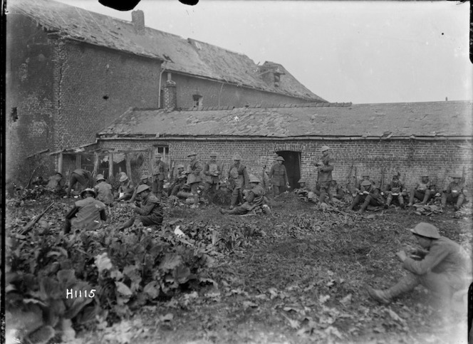 New Zealand soldiers eating after an attack near Solesmes, France, World War I